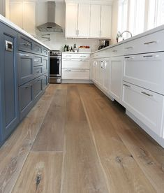 The dusty blue island compliments these prefinished hardwood wide plank flooring perfectly! Wide Plank Flooring, Engineered Hardwood Flooring, Laminate Plank Flooring, Wood Plank Tile, Wood Planks, Planchers En Chevrons, Wood Floor Kitchen, Kitchen Hardwood Floors, Modern Wood Floors