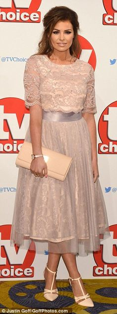 Covered-up: Jess' high-necked, length sleeve top was studded with sequins and offered just a glimpse of her waist from beneath her full bodied, knee length skirt, which boasted a net overlay Celebrity Outfits, Celebrity Style, Chloe Sims, Jessica Wright, Plunge Dress, Choice Awards, Hollywood Celebrities, Dream Dress, Peplum Dress