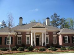 Estate Homes Portfolio | L. Mitchell Ginn & Associates - shows decorative door under the porch