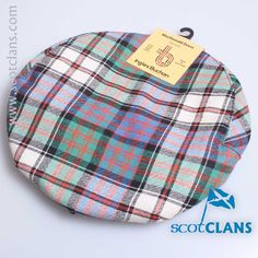 Pure wool cap in MacDonald Dress tartan - available from ScotClans