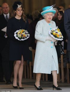 Princess Beatrice of York & Queen Elizabeth handing out traditional Royal Maundy money to pensioners from Britian in York.