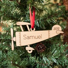 You can find this adorable ornament on Etsy. Wooden Airplane Ornament Baby's First by graphicspaceswood on Etsy, $18.00