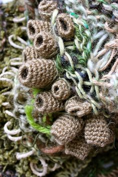 Julia Wright Jewellery, free form knit and crochet/ i m seeing the base for barnacles atop which could be more varied colours and textures