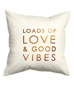 Cushion cover in cotton twill with metallic printed text. Concealed zip. Size 16 x 16 in.