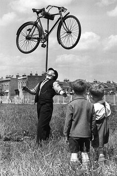 Balancing Act, August 16, 1952 In the field outside his house in Plaistow, east London, 62-year-old railway worker Mo Harris balances a bicy...