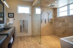 Pratt Designs :: Cherry Creek :: Contemporary Open Shower Master Bathroom #interiordesign #contemporary #masterbathroom #simplistic #openfloorplan #glasswall #concretecountertop #cherrycreek #denver #colorado