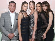 How Bazaar: Sylvester Stallone awkwardly stood as his girls and wife Jennifer worked the camera at a Harper's Bazaar party in Los Angeles on Wednesday
