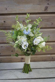 Rustic Bridesmaids Bouquet including Nigella, Rosemary, Larkspur, Scabious, Veronica, Astrantia, Avalanche Roses and seasonal foliage designed and created for a relaxed wedding at Rumbolds Barn, West Sussex. www.hannahberryflowers.co.uk