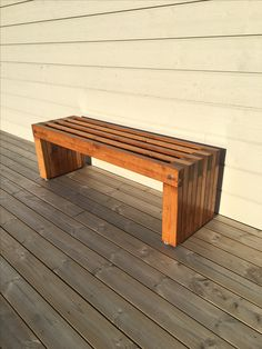 Stained and lacquered pine garden bench.