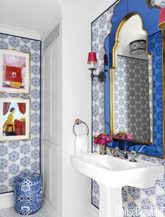 Iksel's Iznik wallpaper lends an Ottoman touch to the powder room.