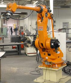 industrial robotic arm - Google Search Industrial Robotic Arm, Industrial Robots, Mechanical Arm, Mechanical Design, Robot Factory, Real Robots, Robot Technology, Robot Arm, Machine Parts