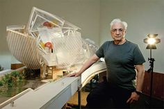 The architect Frank Gehry next to his model of the Fondation Louis Vuitton in Paris.