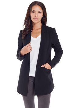 This blazer features back overlay detailing and an exaggerated longer front hem.