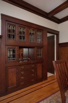 Built-in china cupboard with stained glass doors in an Art and Crafts/Craftsman dining room -- 5918 Dover St, Oakland CA, mls #40614803