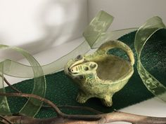 A personal favorite from my Etsy shop https://www.etsy.com/listing/87213419/sale-green-dinosaur-animal-sculpture