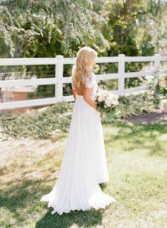 Simple and elegant lace open back wedding dress: http://www.stylemepretty.com/california-weddings/temecula/2016/08/26/backyard-rustic-chic-wedding/ Photography: Erica Schneider - http://ericaschneiderphotography.com/