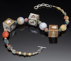 "Jane Martin: About I Try, Necklace in sterling silver, copper, nickel silver, brass, bronze, jasper, and agate. 22-24"" in length."