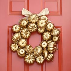 With some spray paint, and cheap pumpkins and gourds, you are on your way to creating this gorgeous gilded fall wreath@