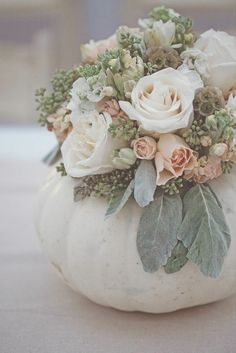An elegant white pumpkin centerpiece. Source: Feather Love Photography. #whitepumpkins #fall #centerpiece