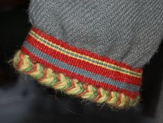 Tablet woven trim detail on sleeve of Viking Reconstruction of the Skoldehamn clothing at the Lofotr Museum