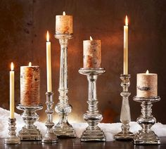 Create a dramatic display of silver and candlelight. Our elongated pillar holders have a sculptural design that mixes the classic turnings of woodwork with a square base and seamless stainless steel top. Mercury Glass Candle Holders, Gold Candle Holders, Glass Candlesticks, Candleholders, Floating Candle Centerpieces, Wedding Table Centerpieces, Hermes Armband, Looking Glass Paint, Bracelet Hermès