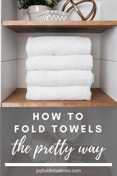 White towels folded nicely on a wood shelf. / Learn how to fold towels for display in bathroom. How to make towels look like a hotel with fancy folding. Learn to save space with decoratively folded towels on rack or in linen closets! Bathroom Shelves, Bathroom Storage, Small Bathroom, Bathroom Ideas, Bathroom Closet, Shower Ideas, Parisian Bathroom, Bathroom Inspiration, Bathroom Spa