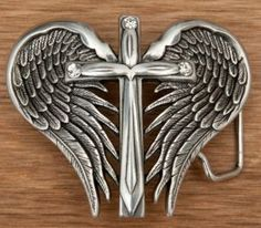 Nocona® Silver Winged Cross Belt Buckle- Dress up your favorite belt with this silver winged cross belt buckle from Nocona Belt Company®. Cross features crystal accents.