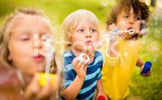 Kids playing with bubbles together having fun royalty-free stock photo