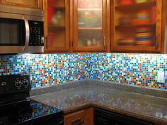 Custom Glass mosaic tile blend backsplash made by MosaicTileSupplies.com to compliment the customer's collection of Fiestaware.