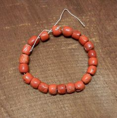 One OOAK Nine Inch Strand Of 22 Antique Red by HammeredEdgeStudio