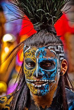a Mayan warrior. Face painting is interesting and the HAIR.