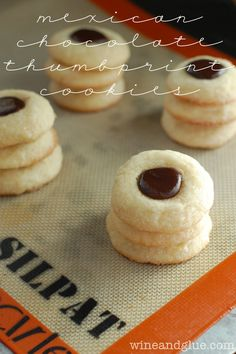 Mexican chocolate thumbprint     1/2 cup heavy cream     1 tsp cinnamon     1/4 tsp cayenne pepper     8 oz milk chocolate chips     2 cups sugar, divided     2 1/2 cups flour     1/2 tsp baking powder     1/2 tsp salt     1 3/4 stick of unsalted butter, softened     2 tsps vanilla extract     2 large eggs