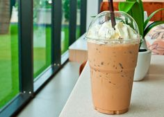 If you want to try a Raspberry-Coffee Frappe, you can make your own gourmet drink at home. Coffee, raspberry syrup, whipped cream, ice cubes, ice cream, chocolate shavings