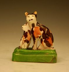 Staffordshire porcelain figure of a cat and kitten c1840
