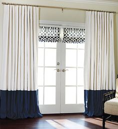 What if we put Roman shades on the two moving doors and used the curtain panels to cover the sidelights.  This would reduce the bulk of the curtains.