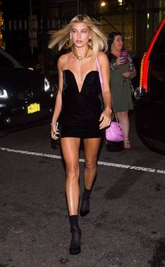 Hailey Baldwin from The Big Picture: Today's Hot Photos  Lady in black! The model stuns in a black velvet Saint Laurent mini dress and pink gucci bag in New York City.