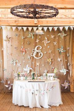 pinwheel backdrop, photo by Rachel Havel http://ruffledblog.com/woodland-park-wedding #receptions #backdrops