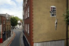 Banksy Iconic 'Well Hung Lover' defaced