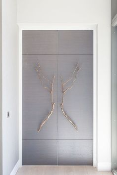 Bespoke doors with bronze branch handles. Design by Stephenson Wright.