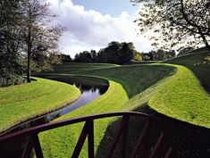 """The Snake Mound from the Jumping Bridge in the Garden of Cosmic Speculation by Charles Jencks, an architectural theorist and landscape architect. Jencks, a Baltimore native, designed the garden at Portrack House in Dumfries and Galloway, where he lives, as """"a landscape conceived as a place to explore certain fundamental aspects of the universe."""" Allan Pollok-Morris"""