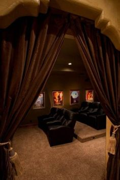 curtains to sheild light from rest of room....step up for second row seating...cool basement ideas home theater 600x899 Impressive Cool Basement Ideas