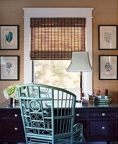 Office? Navy desk, turquoise rattan chair & neutral walls