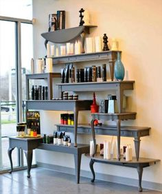 Love this! Repurposed tables in to wall shelves