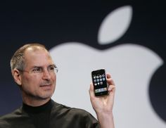Apple CEO Steve Jobs holds up an Apple iPhone at the MacWorld Conference in San Francisco, Jan. 9, 2007. Apple Inc., on a tear with its popular iPod players and Macintosh computers, is expected to report strong quarterly results Wednesday. (AP Photo/Paul Sakuma)