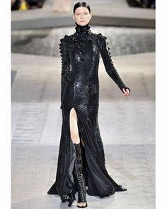 We must agree with Riccardo Tisci: A sci-fi princess should don a skintight spiked high-neck gown with some kick-ass lace-up boots. Imaxtree  - ELLE.com