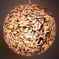 take a paper lantern, add some shredded newspaper and lots of glue and what do you get?  an awesome new lantern!