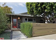 Paint . . . pavers . . . tall grasses Mid century modern bungalow exterior
