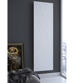 Complex texture with enchanting and mesmerising lines, the embossed motif is able to create brilliant games of light and shade, varying depending on the direction of light, a definite element of the technical design. Vertical Radiators, Electric Radiators, Interior Architecture, Interior Design, Designer Radiator, Towel Warmer, Home Improvement, New Homes, Living Room