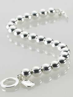 Silver-Plated Ball Bracelet, also from Ralph Lauren. Chunky, toggle latch styling, looks spectacular paired with either the R/L CZ studs or Silver Ball earrings.