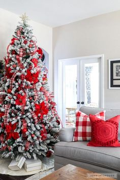 Last Trending Get all white christmas tree red decorations Viral christmas home tour Christmas Tree Game, Flocked Christmas Trees Decorated, White Christmas Tree Decorations, Christmas Home, Holiday Decor, White Christmas Tree With Red, Christmas Tree Poinsettia, Christmas Mantles, Christmas Villages